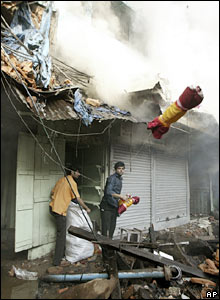People try to save materials from their shops in Calcutta