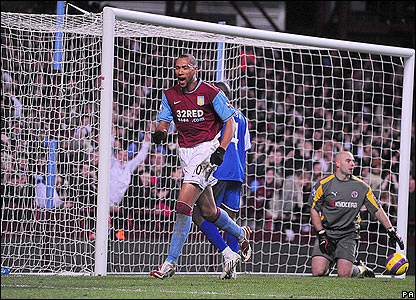 Carew scores his second and Villa's third