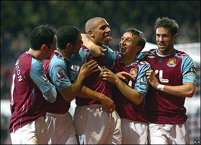 West Ham players congratulate Anton Ferdinand