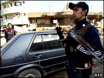 A  Sunni Arab member mans a checkpoint in Baghdad's Adhamiya district.