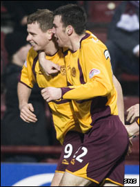 Well scorer Chris Porter (left) celebrates with Paul Quinn