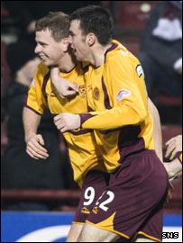 Well scorer Chris Porter (left) celebrates with Paul Quinn