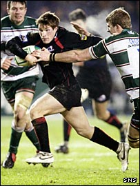 Edinburgh fly-half Phil Godman tries to escape the grasp of Leicester flanker Tom Croft
