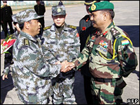 Chinese and Indian army commanders shake hands at the war games in December