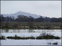 Flooding looking out to Glastonbury Tor, Somerset. Pic by Richard Kellaway