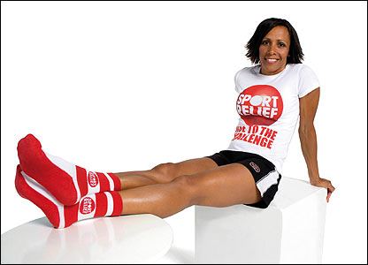 Dame Kelly Holmes shows off her Sport Relief socks