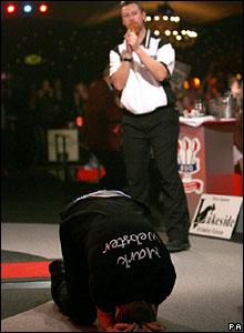 Whitlock looks on as Webster kisses the floor