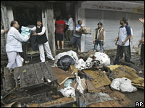 Traders clearing their stores in a market which caught fire in Calcutta