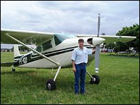 John Carter standing next t his plane