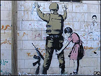 Painting of Israeli soldier being frisked by a girl