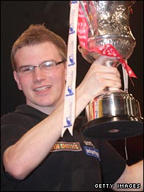 Mark Webster celebrates with the BDO trophy