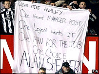 Newcastle fans at Old Trafford with a banner demanding Alan Shearer as their new manager