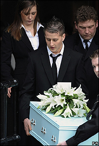 Archie-Lee's mother Rebecca follows his coffin out of the church