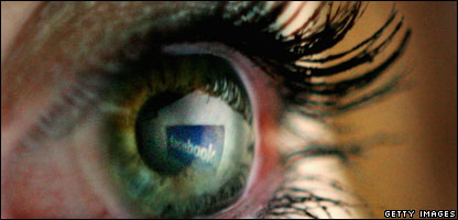 Facebook logo reflected in an eye, Getty