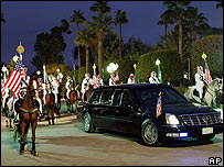 Mr Bush's limousine is given a mounted escort in Riyadh