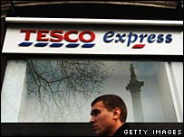 Man walks past Tesco store in central London