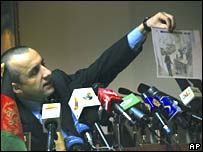 Intelligence chief Amrullah Saleh holds picture of one of the alleged attackers caught on Serena hotel's CC TV, 15 January