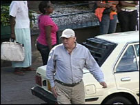 The BBC's world affairs correspondent John Simpson under cover in the Zimbabwean capital Harare