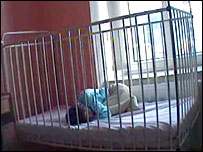 Child in a cage bed in the Czech Republic
