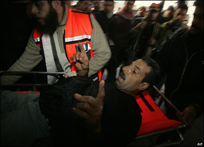 Medics wheel an injured man into a hospital in Gaza City