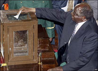 Kenyan President Mwai Kibaki casts his ballot in parliament