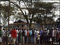 People lining up to get food aid