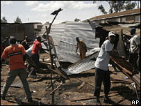 Men rebuilding market stalls