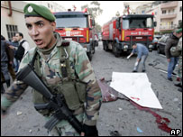A Lebanese soldier secures the area at the site of the explosion in Beirut