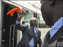 Opposition MP arrives at parliament waving an orange handkerchief