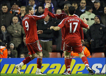 Liverpool's Ryan Babel is congratulated by Fernando Torres and Alvaro Arbeloa