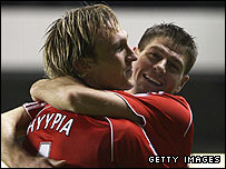 Liverpool hat-trick hero Steven Gerrard celebrates with Sami Hyypia