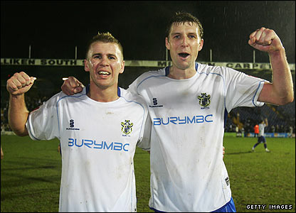Bury goalscorers Andy Bishop and Ben Futcher celebrate their team's win
