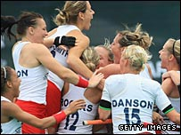 England players celebrate qualifying for the Beijing Olympics
