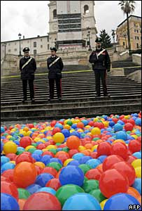 Carabinieri military police stand over plastic balls floating in the fountain in front of the Spanish steps, 16 January 2008