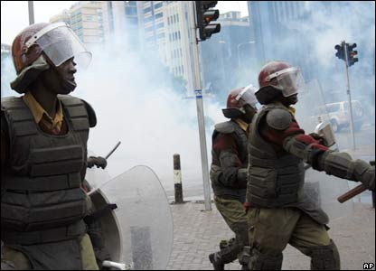 Riot police charge opposition supporters after firing tear gas