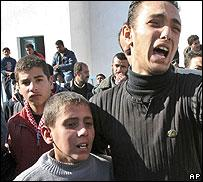 Relatives of air strike victims at Gaza hospital