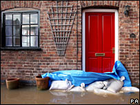 Residents on New Street in Upton, Worcestershire, prepare for the floods