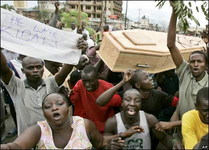 Protesters in Kisumu carry a mock coffin symbolising the death of democracy