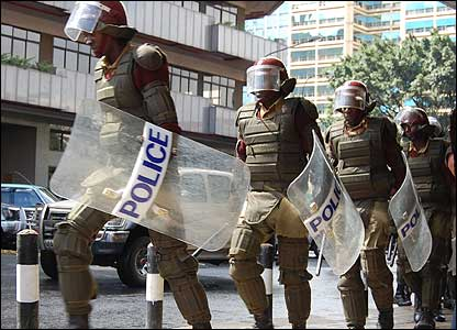 Riot police march down a Nairobi street