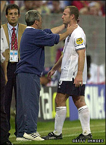 Keegan and Alan Shearer leave the field after defeat to Romania