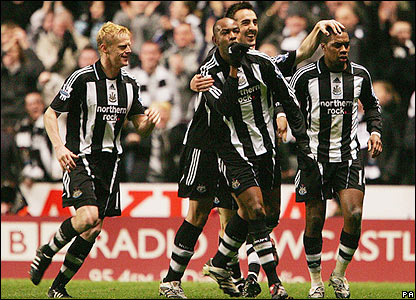 Claudio Cacapa is congratulated after scoring Newcastle's second