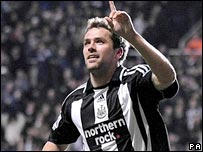 Michael Owen celebrates scoring for Newcastle