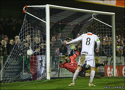 Swansea keeper Dorus De Vries fails to stop Tom Jordan's header finding the net