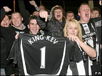 Fans celebrate the return of Kevin Keegan to the club