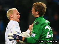 West Ham's Dean Ashton clashes with Man City keeper Joe Hart