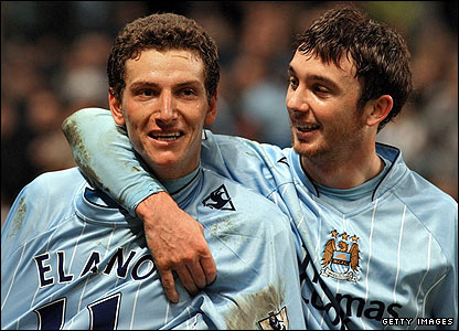 Blumer Elano is congratulated after giving Man City the lead