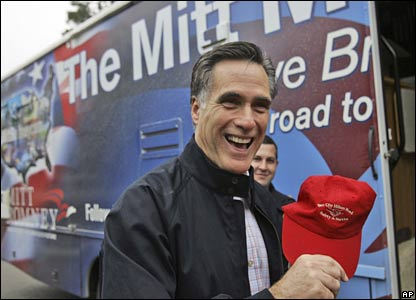 Mitt Romney laughs after being given a cap by security guards at a retirement home in Bluffton, South Carolina