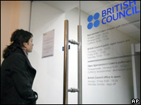 Woman looks at British Council sign
