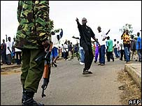 A protester taunts a policeman in Kisumu on 16 January