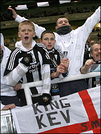 Newcastle fans celebrate Keegan's return during the FA Cup replay with Stoke